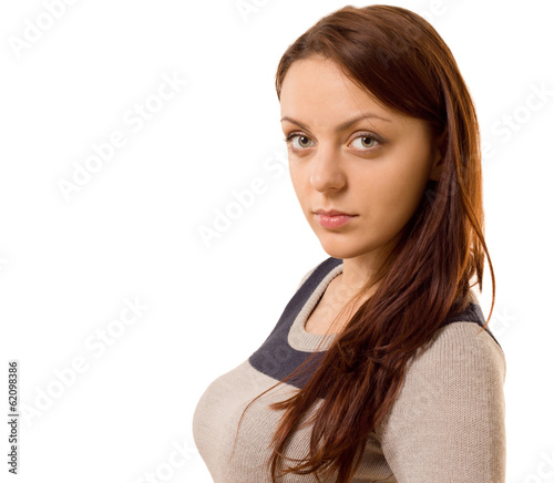 Young woman raising an eyebrow at the camera