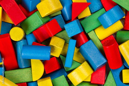 Toys blocks, multicolor wooden building bricks, colorful heap
