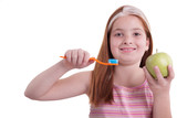 young girl with toothbrush and fresh green apple