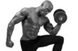 Bodybuilder training with heavy dumbbell