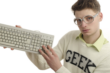 Geek playing video games with a keyboard, gamer wearing eyeglass