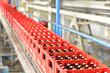 Bierkästen auf Fliessband in e. Brauerei // brewery beer bottles