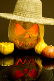 Halloween pumpkins with straw hat