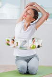 Woman with virtual pictures of her training program around her