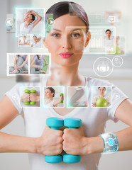 Woman doing exercise with dumbbells wearing smart wearable devic
