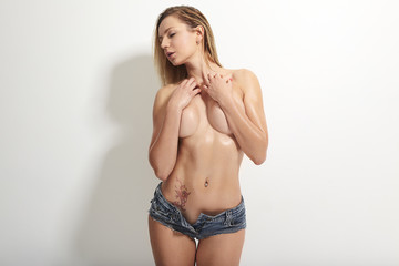 topless girl in blue shorts