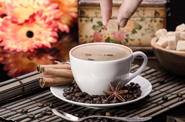 Brown sugar on a cup of coffee  with anise and cinnamon