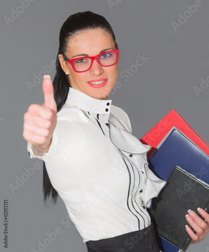 Smiling business woman thumb up show