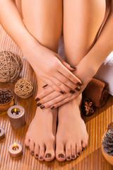 beautiful brown manicure and pedicure