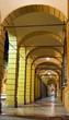 Постер, плакат: Bologna arches night street life