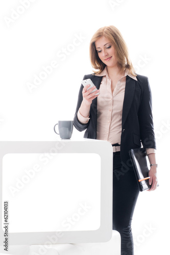 Business woman reading an SMS while at work