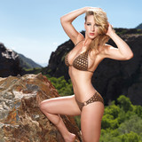 stunning sexy blonde posing in montains in bikini
