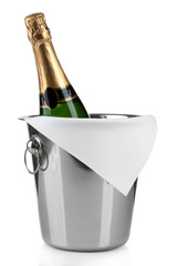 Bottle of champagne in pail isolated on white