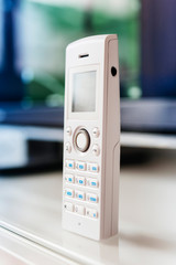 Cordless internet phone on office table