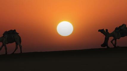 cameleers leading caravan of camels in desert - silhouette again
