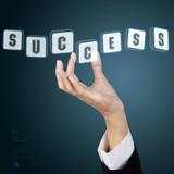 Businessman hand and word success. Concept of business success.