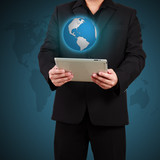 Businessman holding a tablet with globe