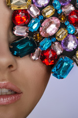 Woman with multicolored stones