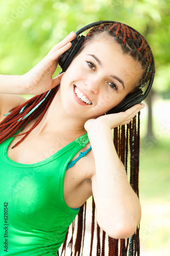 listening music girl in the park