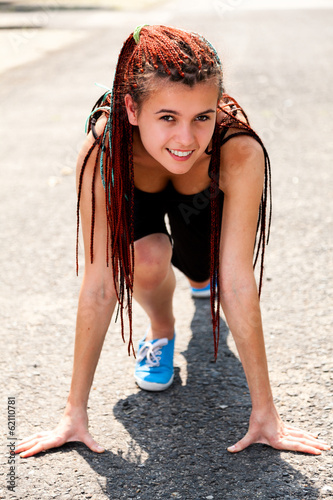 teen girl preparing to run