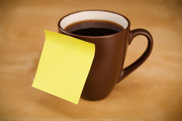 Empty post-it note sticked on cup