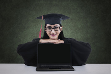A graduate student with blank screen laptop