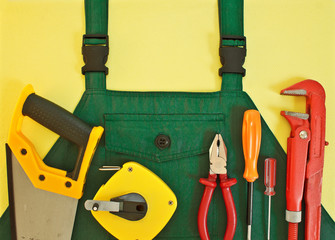 Background with coveralls and a set of tools