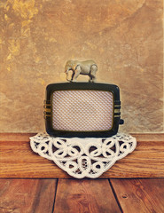 old radio with a toy elephant on the vintage background