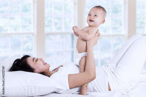 Attractive mother laughing together with her baby