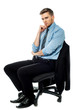 Pensive businessman sitting on the chair