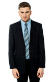 Smart male business executive posing to camera