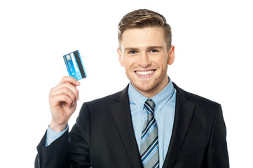 Business man holding a credit card