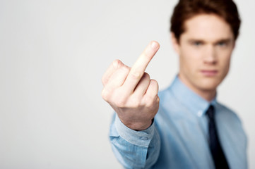 Corporate guy showing middle finger