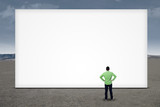 Businessman standing in front of blank board