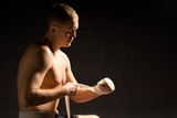 Muscular young boxer preparing for a fight