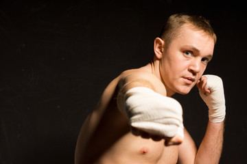 Young boxer punching towards the camera