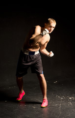 Agile young boxer moving around in the ring