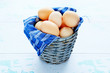 Fresh chicken eggs in an old bucket
