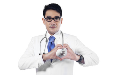 Closeup of doctor making heart shape