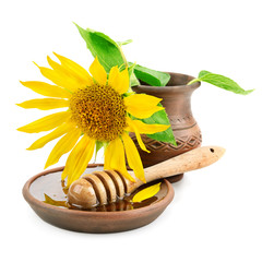clay dish with honey drizzler and flowers sunflowers