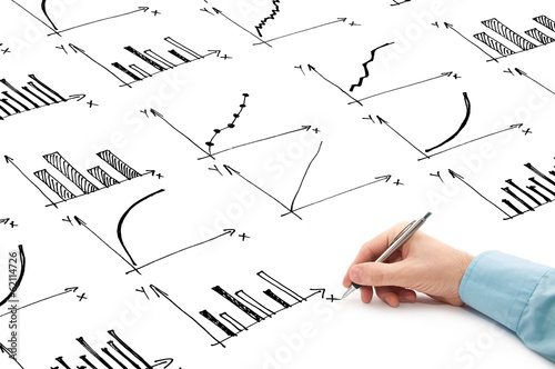 Businessman drawing bar chart and other infographics in note pad