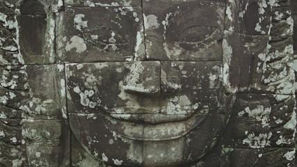 Huge stone face on the wall. Bayon, Angkor, Cambodia