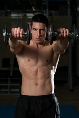 Young Athlete Exercise Power Boxing With Dumbbells