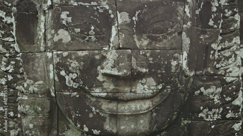 Huge stone face on the wall. Bayon, Angkor, Cambodia