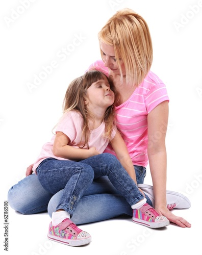 Pretty little girl with mother isolated on white