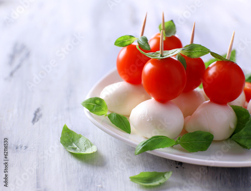 Tasty mozzarella cheese with basil and tomatoes