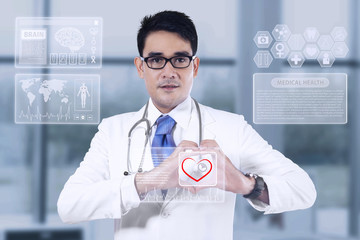 Medical doctor showing heart shape