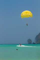 Parachute surfer being hauled by a motorboat in Thailand