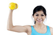Sporty woman with dumbbell
