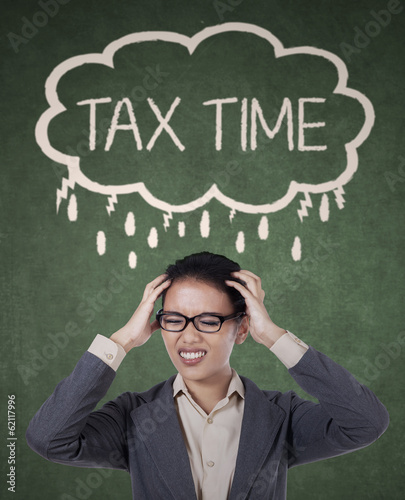 Businesswoman stressing out thinking about tax